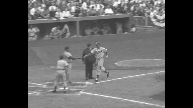 close up of duke snider brooklyn dodgers with baseball bat / long shot of new york yankees manager casey stengel signaling from dugout / whitey ford... - frivarv bildbanksvideor och videomaterial från bakom kulisserna