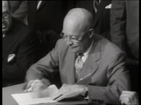 vídeos y material grabado en eventos de stock de close up of dwight eisenhower signing paper / white house / no sound - only mature men