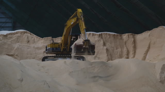 close up of earth mover digging in stack of sugar raw sugar inside the warehouse at msm sugar refinery sdn bhd in pasir gudang johor malaysia on... - johor stock videos & royalty-free footage