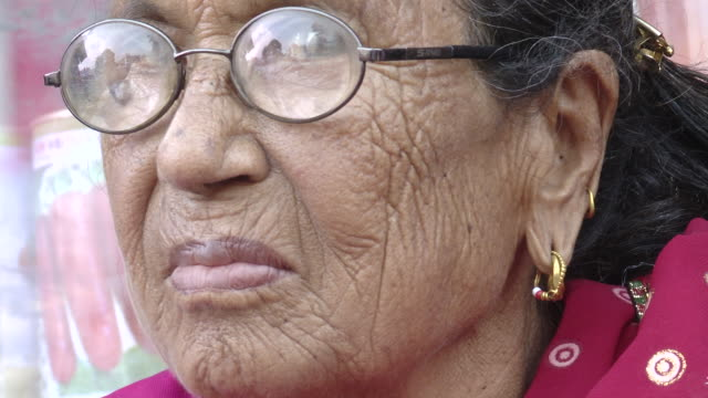 Close up of elderly Nepalese woman in glasses