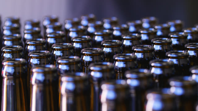 close up of empty brown glass bottles lined up neatly on a crate - beer bottle stock videos & royalty-free footage