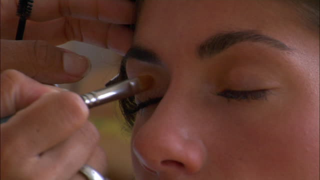 Close up of eye shadow being applied on model
