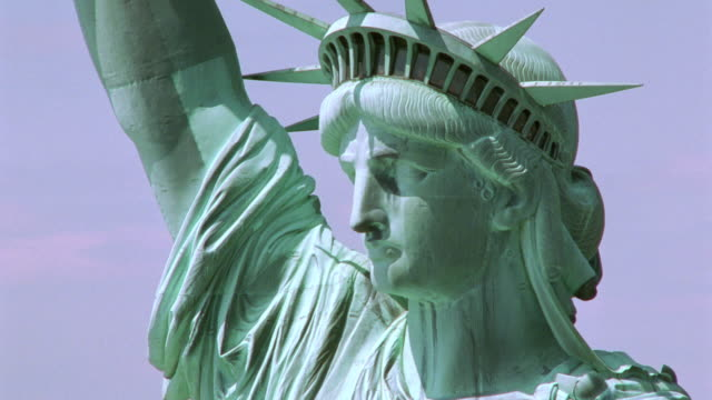 aerial close up of face of statue of liberty / nyc - statue of liberty new york city stock videos & royalty-free footage