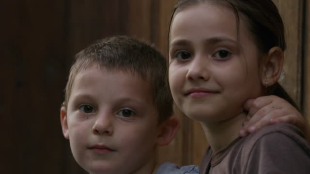 close up of faces of brother and sister / veliko tarnovo, bulgaria - brother stock videos & royalty-free footage