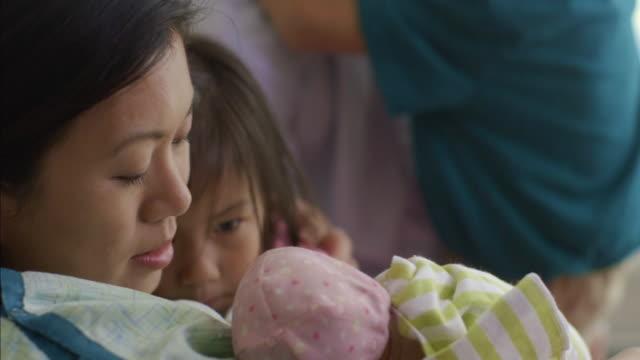 Close up of family admiring newborn baby