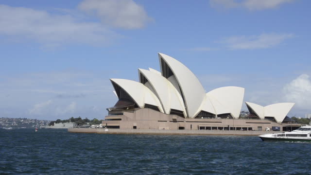 Close up of famous Sydney Opera House of Sydney Australia with ferry boat in New South Wales