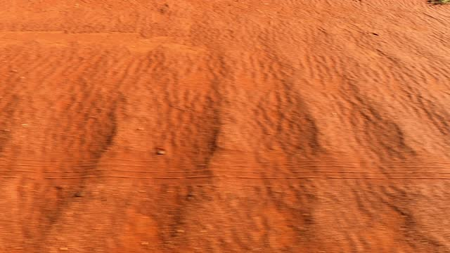 close up of fast moving red dirt road outback australia - dirt track stock videos & royalty-free footage