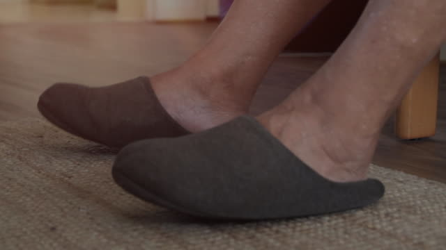 close up of feet in slippers tapping - slipper stock videos and b-roll footage