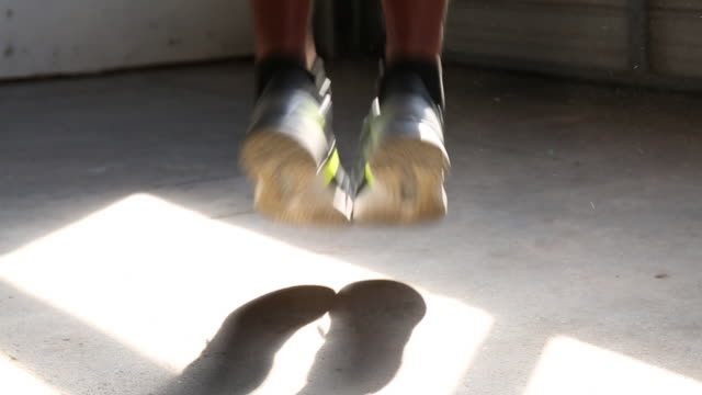 close up of feet of african american man jumping rope - jump rope stock videos and b-roll footage