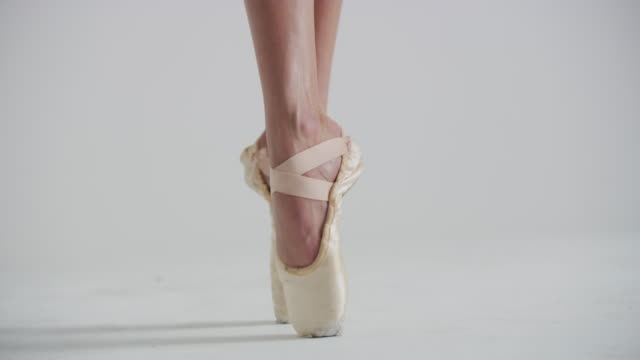 close up of feet of woman ballet dancer on pointe in studio - ballet dancer stock videos & royalty-free footage