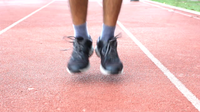 close up of feet skipping jump rope - skipping stock videos & royalty-free footage