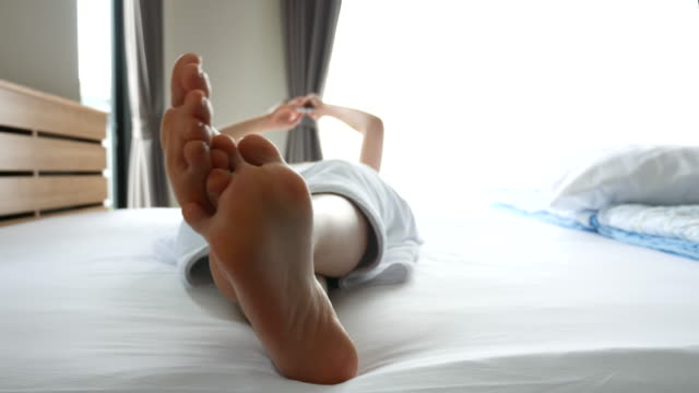 Close up of female feet in bed, Resting