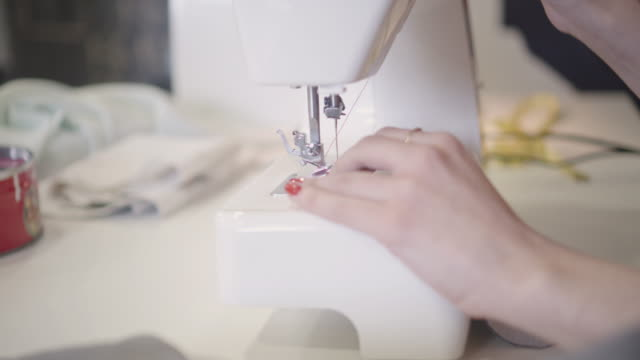 4K: Close Up Of Female Hands On Sewing Machine.