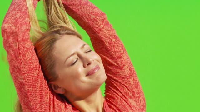 close up of female smiling, stretching arms out and looking up to the sky - människoarm bildbanksvideor och videomaterial från bakom kulisserna