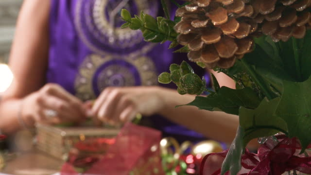 close up of festive woman wrapping gifts - christmas wrapping paper stock videos & royalty-free footage