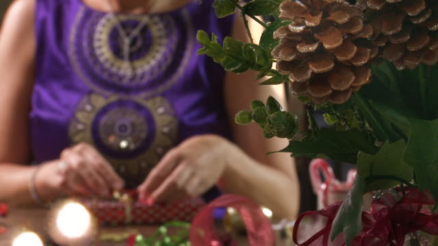 close up of festive woman wrapping presents - christmas wrapping paper stock videos & royalty-free footage
