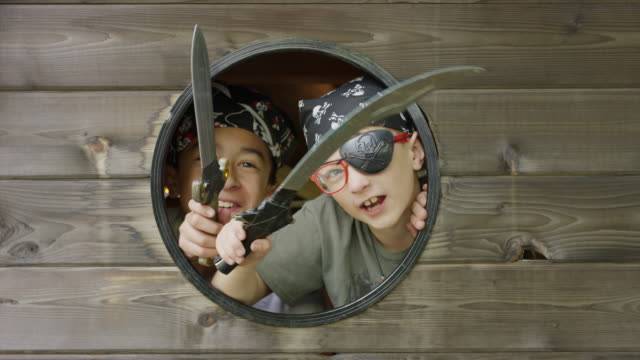 close up of fierce boys playing pirate in window with swords / provo, utah, united states - provo stock videos & royalty-free footage