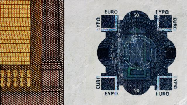 vídeos de stock, filmes e b-roll de feche acima de 50 euro-características da segurança da nota de banco. - parte de