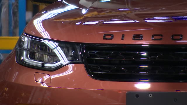 close up of finishes jaguar land rover discovery vehicle on production line with hazard lights flashing - land vehicle stock videos & royalty-free footage