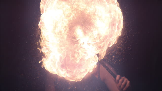 close up of fire blower blowing fire  - riposarsi video stock e b–roll
