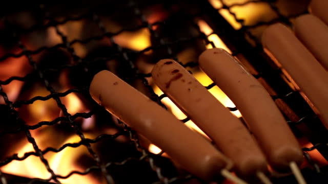 close up of fired hot dog on grille - roast beef sandwich stock videos & royalty-free footage