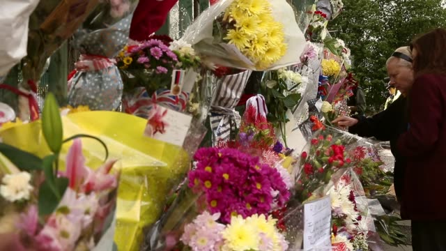 close up of flowers left at the scene where drummer lee rigby of the 2nd battalion the royal regiment of fusiliers was killed, on may 24, 2013 in... - fundamentalism stock videos & royalty-free footage