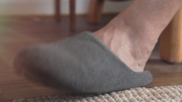 close up of foot in slipper tapping