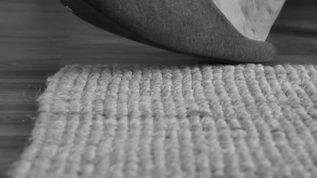 close up of foot with slipper tapping on carpet - einzelner senior stock-videos und b-roll-filmmaterial