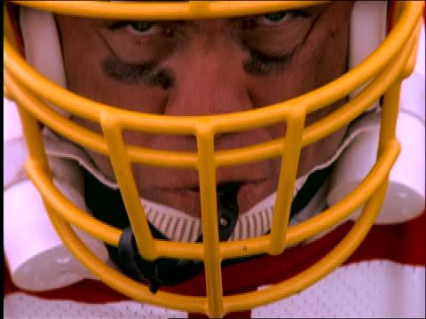 close up of football player's face looking at camera