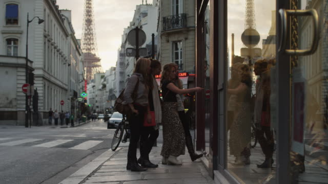 close up of friends window shopping on city street / paris, france - social gathering stock-videos und b-roll-filmmaterial