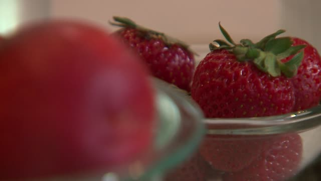 wgn close up of fruit on a kitchen island on june 2 2016 - plum stock videos & royalty-free footage