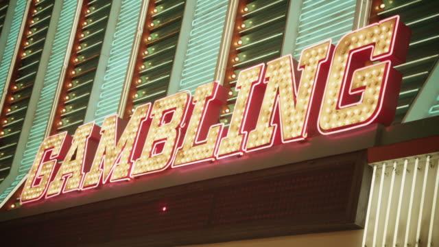 close up of gambling illuminated sign, las vegas - casino icon stock videos & royalty-free footage