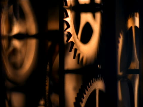close up of gears moving inside of clock - clockworks stock videos & royalty-free footage