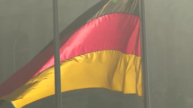 """close up of german flag blowing in breeze outside reichstag parliament building in berlin - """"bbc news"""" stock-videos und b-roll-filmmaterial"""