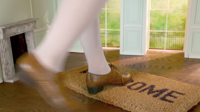 close up of giant woman walking on welcome mat in tiny house - welcome mat stock videos and b-roll footage