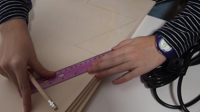 close up of girl hand´s doing crafts. she design and paints with a christmas tree with the help of a ruler on a wood plank. christmas time in germany, europe. - one teenage girl only stock videos & royalty-free footage