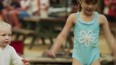 stockvideo's en b-roll-footage met close up of girl in bathing suit dancing / idaho, united states - swimwear