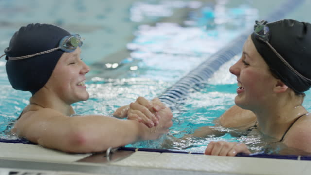 vidéos et rushes de close up of girl in swimming pool shaking hands with competitor / provo, utah, united states - provo