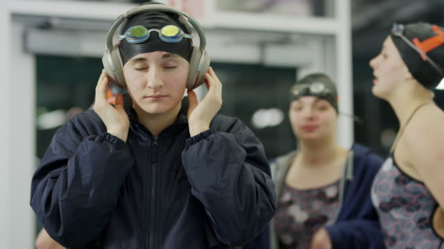close up of girl listening to music on headphones preparing for swimming / provo, utah, united states - provo stock videos & royalty-free footage