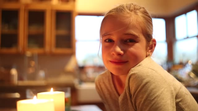 close up of girl looking at candle - 10 11 år bildbanksvideor och videomaterial från bakom kulisserna
