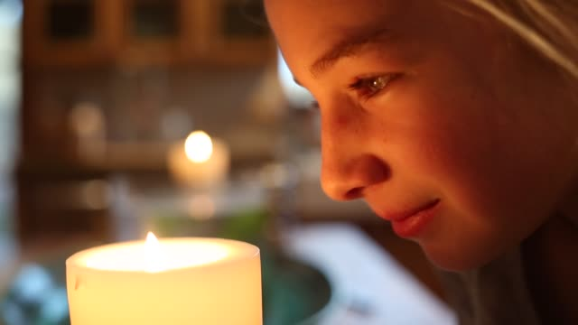 close up of girl looking at candle - 10 11 jahre stock-videos und b-roll-filmmaterial