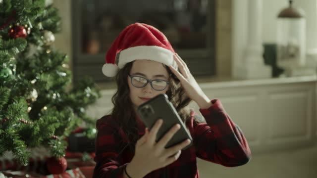 close up of girl posing for cell phone selfie on christmas / orem, utah, united states - orem utah stock videos & royalty-free footage