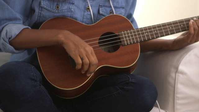 close up of girl strumming ukulele - fretboard stock videos & royalty-free footage
