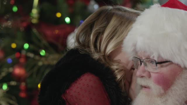 close up of girl whispering into santa's ear - whispering stock videos & royalty-free footage