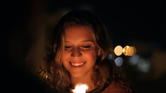 close up of girlfriend lighting sparkler over the shoulder of boyfriend - boyfriend stock videos & royalty-free footage