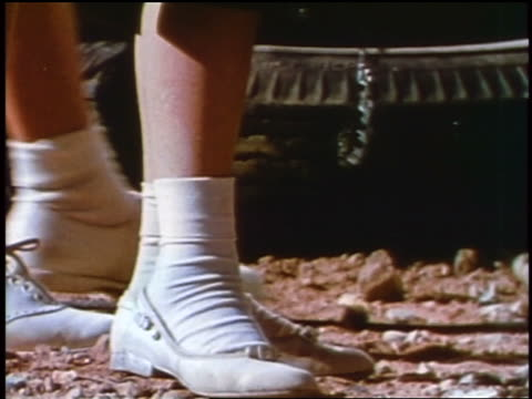 stockvideo's en b-roll-footage met 1957 close up of girls' feet in white shoes + socks outdoors / feature - 1957