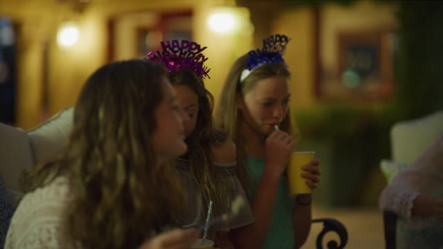 stockvideo's en b-roll-footage met close up of girls holding cups and laughing at birthday party / cedar hills, utah, united states - feestmuts