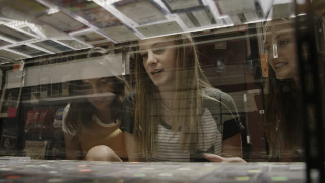 close up of girls shopping in store for merchandise in glass display case / provo, utah, united states - display cabinet stock videos & royalty-free footage