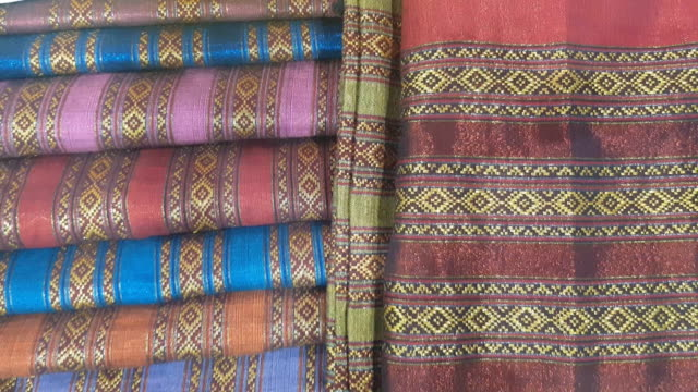 close up of gold silk weaving on loom, cotton on the manual wood loom in asian traditional culture and woman hand weave lifestyle, thailand - sari stock videos and b-roll footage