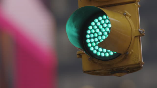 Close up of green traffic light in light rain